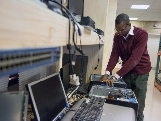 Ward 8 resident learns the art of computer refurbishing. (Courtesy photo)