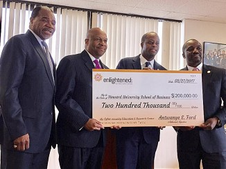Barron Harvey, dean of Howard University School of Business, Antwanye Ford, president and CEO of Enlightened Inc., Howard President Wayne A.I. Frederick and Andre Rogers, executive vice president/CFO of Enlightened Inc., celebrate a $200,000 gift from Enlightened to Howard's business school on March 9. (Courtesy of Enlightened Inc.)