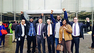 Gary Gathers (second from left) and Keith Mitchell (third from right) celebrate their freedom after murder convictions against them were overturned and the charges dismissed. (Courtesy photo)