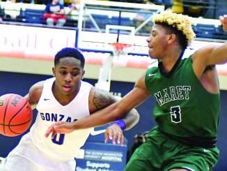 Gonzaga Eagles guard Chris Lykes (0) drives past Maret Frogs guard Coby Davis during Gonzaga's 77-66 win in the DCSAA boys' championship game at the George Washington Smith Center in Northwest on Sunday, March 5. (John E. De Freitas/The Washington Informer)