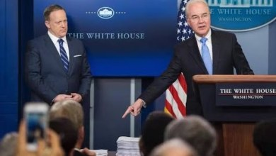 Health and Human Services Secretary Tom Price points out a side-by-side comparison of the Affordable Care Act and the much-smaller GOP replacement proposal during a March 7 press briefing as White House Press Secretary Sean Spicer looks on.