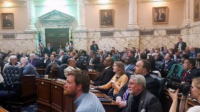 Members of the House of Delegates stare at the clock as it ticks down to midnight on April 10, the last day of the Maryland General Assembly. (William J. Ford/The Washington Informer)