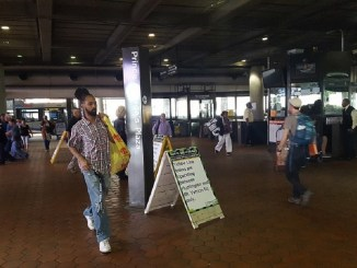 Riders arrive at the Prince George's Plaza Metro station on April 21. (William J. Ford/The Washington Informer)