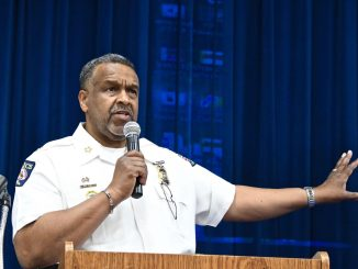 District Heights Police Chief Elliott Gibson Sr. talks about how parents can prevent their child from disappearing during an April 13 town hall at the city's municipal building. (Travis Riddick/The Washington Informer)