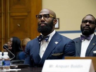 NFL football player Anquan Boldin joins congressional members of the Committee on the Judiciary at a forum on Capitol Hill on March 30 discussing experiences to help build trust between communities and police. (Lateef Mangum)