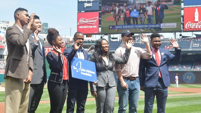 Scholars from the Jackie Robinson Foundation take the field for a pregame ceremony on Jackie Robinson Day at Nationals Park in Southeast on April 15. (John De Freitas/The Washington Informer)