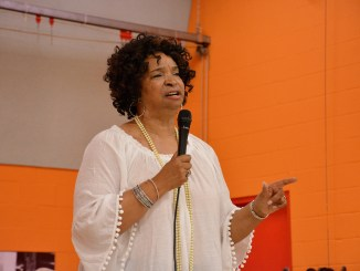 """Guest speaker Dr. Lonise Bias, the mother of the late basketball standout Len Bias, addresses an audience of mothers who have lost children to violence during Helping Hands, Inc.'s fifth annual """"Healing Hands"""" Mother`s Day Celebration in southeast D.C. on May 5. (Roy Lewis/The Washington Informer)"""