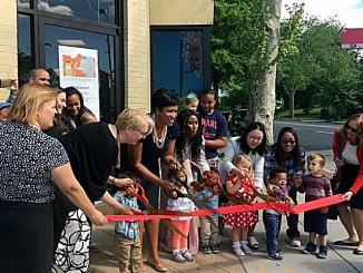 D.C. Mayor Muriel Bowser, Deputy Mayor for Education Jennifer Niles and Deputy Mayor for Health and Human Services HyeSook Chung join for a ribbon-cutting ceremony at the new Curious Explorers Child Development Center in northwest D.C. on May 3. (Courtesy photo)