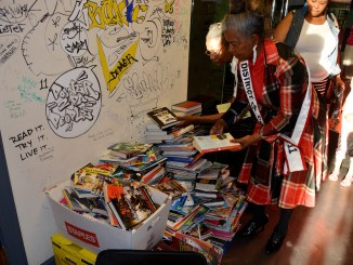 Ms. Senior District of Columbia Emma P. Ward donates books to the new Charnice Milton Community Bookstore in Southeast on May 17. (Roy Lewis/The Washington Informer)