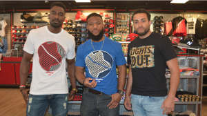 Models showcase the Lights Out active wear T-shirts at a DTLR location in D.C. on May 17. (Steve Garrett)