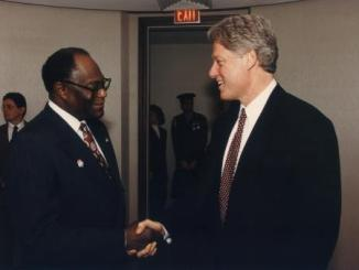 **FILE** Eddie Williams (left) shakes hands with then-President Bill Clinton (Courtesy of Joint Center for Political and Economic Studies)