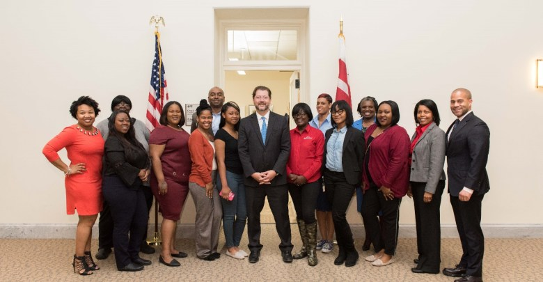 D.C. Council member David Grosso meets with AmeriHealth Caritas employees and interns from its Pathways to Work program at the Wilson Building in the District. (Kea Taylor)
