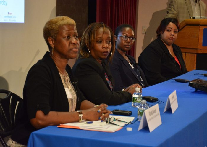 """From left: Alfreda Woods, cancer program manager at the D.C. Department of Health; Rene Nash, news and public affairs director at 96.3 FM (WHUR) and cancer survivor; Jasmaine McCain, cancer biologist; and Dr. LeeAnn Bailey participate in a panel discussion during the Sibley Oncology Clinic at United Medical Center's """"Cancer Awareness Day"""" in southeast D.C. on May 20, 2017. (Roy Lewis/The Washington Informer)"""