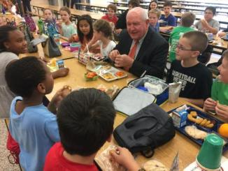 Secretary of Agriculture Sonny Perdue eats lunch with students at Catoctin Elementary School in Leesburg, Va. (Courtesy of USDA)