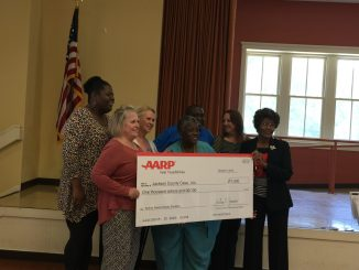 Joyce Nelson (center) of Moss Point won the 2016 AARP Mississippi Andrus Award for Community. (Courtesy of AARP)