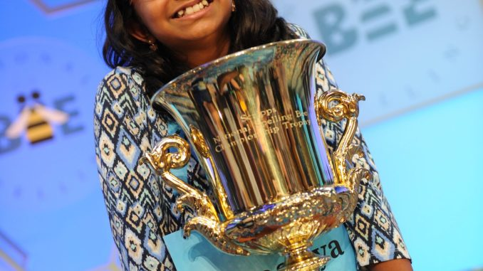 Ananya Vinay of Fresno, California, shows off her trophy after winning the 90th annual Scripps National Spelling Bee at the Gaylord National Resort & Convention Center in Oxon Hill, Maryland. (Courtesy of Scripps)