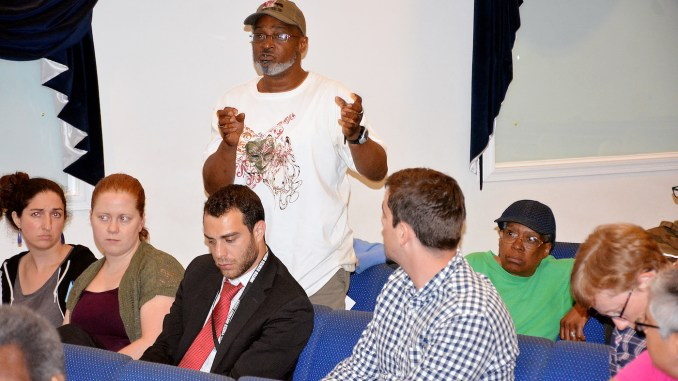 Residents of the Ward 4 Petworth neighborhood voice their concerns regarding a youth detention center set open in the area during a June 8 community meeting at Centro Evangelistico Church in Northwest. (Roy Lewis/The Washington Informer)