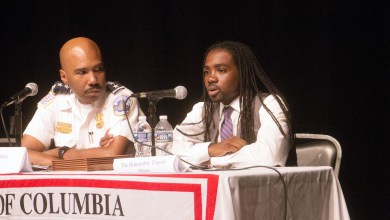Ward 8 Patrol Chief Robert Contee and Ward 8 Council member Trayon White participate in the Violence Prevention Town Hall at THEARC auditorium in southeast D.C. on July 19, 2017. (Mark Mahoney/The Washington Informer)