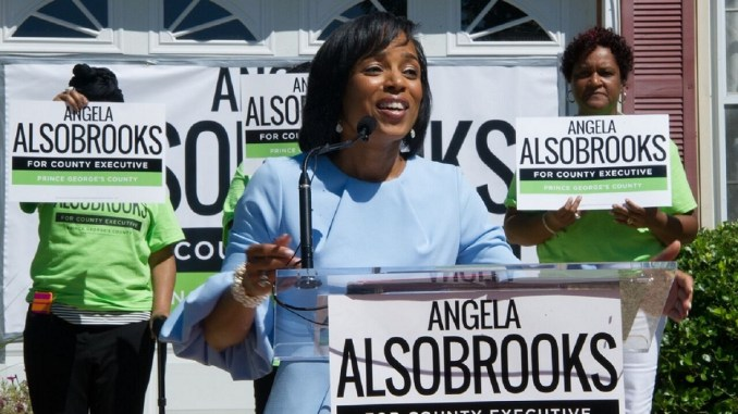 Prince George's County State's Attorney Angela Alsobrooks announces her candidacy for county executive in front of her parents' home in Camp Springs on July 31. (Lateef Mangum/The Washington Informer)