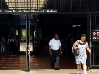 Metrorail riders walk outside the Addison Road-Seat Pleasant station on June 29. (William J. Ford/The Washington Informer)