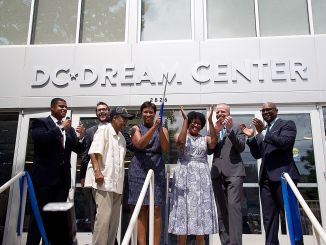 Mayor Muriel Bowser and D.C. Dream Center officials cut the ribbon and open the doors for the newly renovated facility in southeast D.C. on Aug. 23. (Lateef Mangum/The Washington Informer)