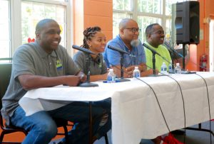 Daryl Dudley, Jarriel Jackson and Pastor Paul Larrette, and UCAP Board Chair Albert Charten on a panel for United Against Poverty in Capitol Heights, Md., on Aug. 5. (Demetrious Kinney/The Washington Informer)
