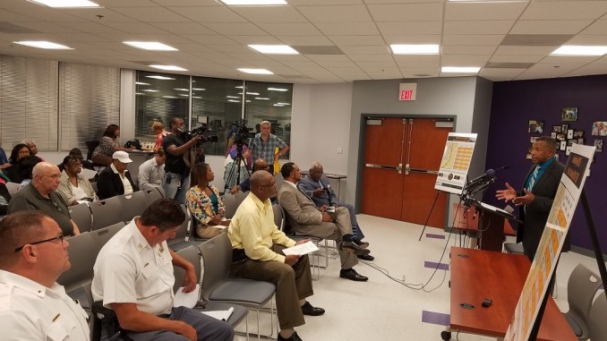 The Rev. Roger L. Screen (right) leads a Sept. 18 discussion on ideas to improve safety along Route 210 in southern Prince George's County, which AAA Mid-Atlantic labeled the most dangerous road in the region. (William J. Ford/The Washington Informer)