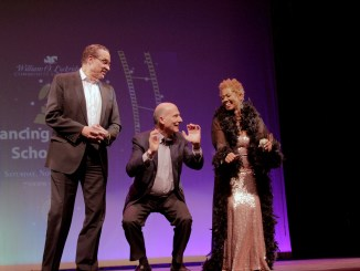 """""""Dancing with the Scholars"""" guest judges Council member Vincent Gray (D-Ward 7) and Council Chairman Phil Mendelson (D-At- Large) join WOLCF founder Wanda Lockrigde on stage for a dance to celebrate their November birthdays. (Corey Parrish/The Washington Informer)"""