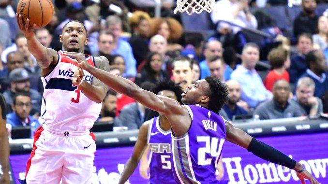 Washington Wizards guard Bradley Beal attempts a layup against Sacramento Kings guard Buddy Hield during the Wizards' 110-92 victory at Capital One Arena in D.C. on Nov. 13. (John De Freitas/The Washington Informer)