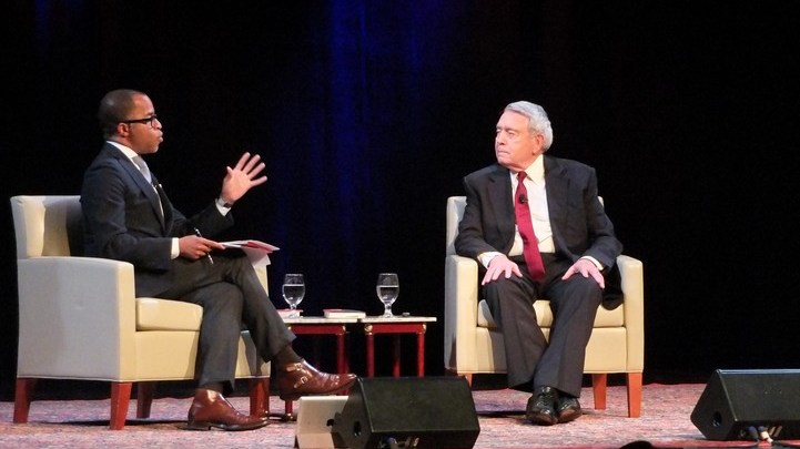 """Jonathan Capehart (left), a Pulitzer Prize-winning journalist, interviews renowned news correspondent Dan Rather about Rather's new book, """"What Unites Us,"""" at the G.W. Lisner Auditorium in D.C. on Nov. 9. (Courtesy of Bruce Guthrie)"""