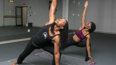 Omekongo Dibinga and Kendra Blackett-Dibinga pose in harmony at their Ivy City yoga studio. (Shevry Lassiter/The Washington Informer)