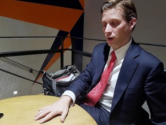 Maryland gubernatorial candidate Alec Ross talks about his campaign at Compass Coffee in northwest D.C. on Dec. 13. (William J. Ford/The Washington Informer)