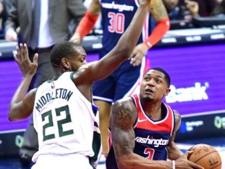 Washington Wizards shooting guard Bradley Beal (3) drives to the basket against Milwaukee Bucks forward Khris Middleton in the first quarter of the Bucks' 110-103 win at Capital One Arena in D.C. (John De Freitas/The Washington Informer)