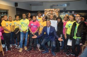 Youth participating in the U.S. Dream Academy were selected to attend a premiere of Black Panther at the Majestic Theater in Northwest on Sunday, Feb. 18. Guy Lambert (center), WPGC-95.5 news host, led a discussion with the youth after viewing the film. (Shevry Lassiter/The Washington Informer)