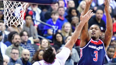Washington Wizards guard Bradley Beal shoots over Philadelphia 76ers forward Dario Saric during the Wizards' 109-94 win at Capital One Arena in D.C. on Feb. 25. (John De Freitas/The Washington Informer)
