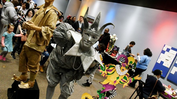 Hundreds pack the Smithsonian's Anacostia Community Museum for its annual Mardi Gras Family Day on Feb. 10. (Roy Lewis/The Washington Informer)