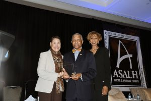 Evelyn Brooks Higginbotham and Shelia Flemming-Hunter present an award to Edgar Brookins, general manager of the Afro-American Newspapers during the 92nd annual Black History Luncheon at the Washington Renaissance Hotel in D.C. on Feb. 24. (Roy Lewis/The Washington Informer)