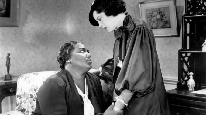 """Louise Beavers (left) plays a maid whose daughter (Fredi Washington) passes for White in """"Imitation of Life."""" (Courtesy of Universal Pictures)"""