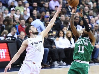 Boston Celtics guard Kyrie Irving shoots a fadeaway jump shot over Washington Wizards guard Tomas Satoransky in the second quarter of the Celtics' 110-104 overtime victory at Capital One Arena in D.C. on Feb. 8. (John De Freitas/The Washington Informer)