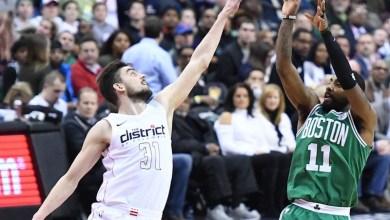 Boston Celtics guard Kyrie Irving shoots a fadeaway jump shot over Washington Wizards guard Tomas Satoransky in the second quarter of the Celtics' 110-104 overtime victory at Capital One Arena in D.C. on Feb. 8. (John De Freitas/The Washington Informer)