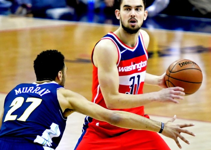 Washington Wizards guard Tomas Satoransky is defended by Denver Nuggets guard Jamal Murray during the Nuggets' 108-100 win at Capital One Arena in D.C. on March 23. (John De Freitas/The Washington Informer)