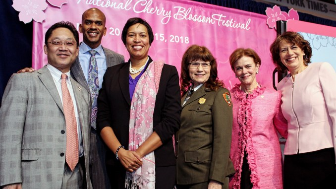 From left: Japanese Embassy Minister of Public Affairs Takehiro Shimada; Gregory A. O'Dell, president and CEO of EventsDC; Mayor Muriel Bowser; Karen Cucurullo, superintendent for the National Mall and Memorial Parks of the National Park Service; Newseum and Newseum Institute Trustee Jan Neuharth; and National Cherry Blossom Festival President Diana Mayhew pose at a March 1 press conference in northwest D.C. to announce the 2018 Cherry Blossom Festival events. (Brigette White/The Washington Informer)