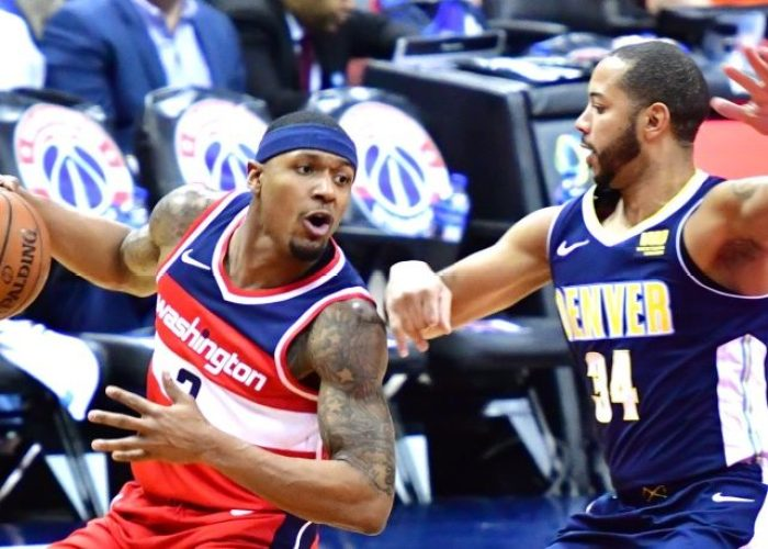 Washington Wizards guard Bradley Beal drives against Denver Nuggets guard Devin Harris during the first half of the Nuggets' 108-100 win at Capital One Arena in D.C. on March 23. (John De Freitas/The Washington Informer)