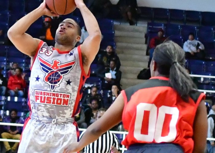 The Washington Fusion's Andre Barrett shoots over the Chicago Vikings' Shannon Bobbit during the Fusion's 118-91 win in an exhibition game for the new Global Mixed Gender Basketball League at Howard University's Burr Gymnasium in D.C. on March 24. (John E. De Freitas/The Washington Informer)