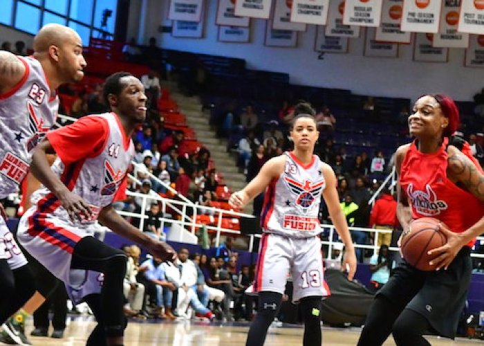 The Chicago Vikings' Necole Sterling takes on several Washington Fusion defenders during the Fusion's 118-91 win in an exhibition game for the new Global Mixed Gender Basketball League at Howard University's Burr Gymnasium in D.C. on March 24. (John E. De Freitas/The Washington Informer)