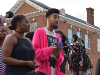 Members of HU Resist Alexis McKenny (left) and Juan Demetrixx speak during a March 30 press conference by a group of students protesting the university's financial-aid embezzlement scandal. (WUSA-TV via Howard University News Service)