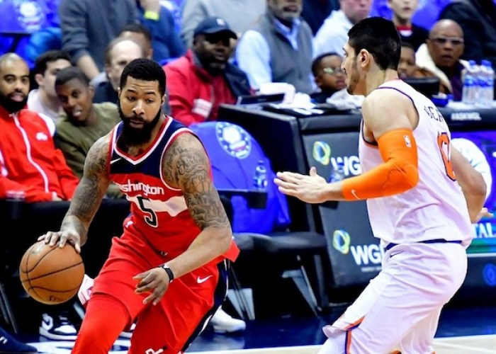 Washington Wizards forward Markieff Morris drives against New York Knicks center Enes Kanter in the second quarter of the Knicks' 101-97 win at Capitol One Arena in D.C. on March 25. (John De Freitas/The Washington Informer)