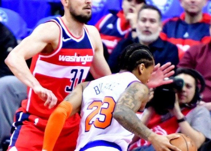 New York Knicks guard Trey Burke drives against Washington Wizards point guard Tomas Satoransky in the second quarter of the Knicks' 101-97 win at Capitol One Arena in D.C. on March 25. (John De Freitas/The Washington Informer)