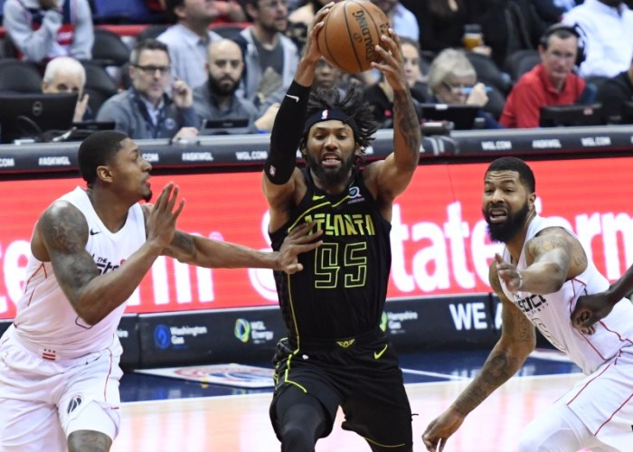 Atlanta Hawks guard DeAndre' Bembry is defended by Washington Wizards guard Bradley Beal (3) and forward Markieff Morris in the first quarter of the Hawks' 103-97 win at Capital One Arena in D.C. on April 6. (John De Freitas/The Washington Informer)