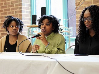 Annette Moukoury (center) participates in an April 14 discussion on the school-to-prison pipeline at Bowie High School. Beside Moukoury are Marie Moukoury (left) and Osato Charles-Omoregbee. (Brigette White/The Washington Informer)